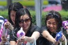 Young Thais play water battle games to mark the start of the Songkran festival, at a shopping mall in Bangkok.