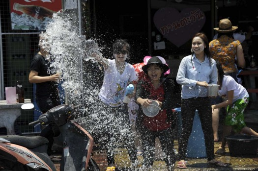 Thai people celebrate the Songkran water festival in Thailand's southern province of Narathiwat.