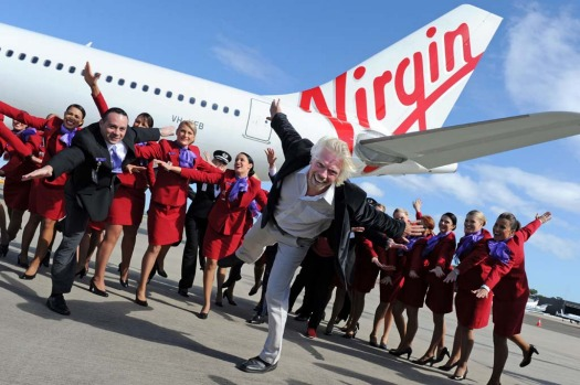 British tycoon Richard Branson (C) and Virgin Australia CEO, John Borghetti (L) try to gain altitude beside the new ...
