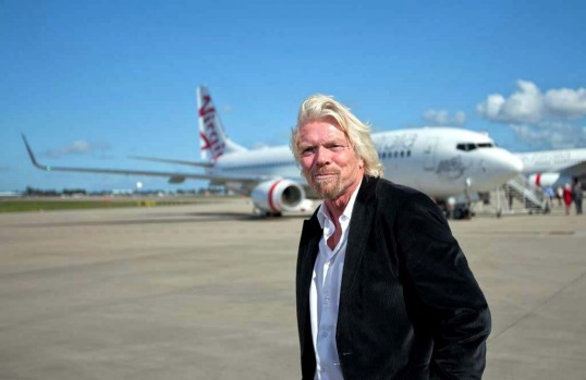 Richard Branson, chairman and founder of Virgin Group poses for the media during the unveiling of the new face of the ...