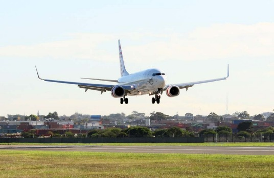 Virgin Australia's new Boeing 737 comes in to land for the rebranding launch.