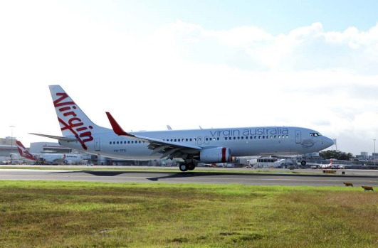 Virgin Australia's new  Boeing 737 airplane touches down on the tarmac just prior to the  rebranding launch.