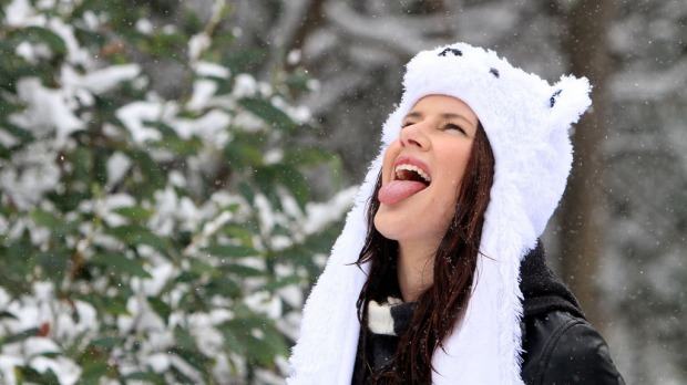 Falls Creek resident Laura McCoombe gets a 'taste of winter' in autumn at Falls Creek.