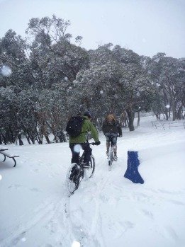 Biking through the early snow at Mount Buller.