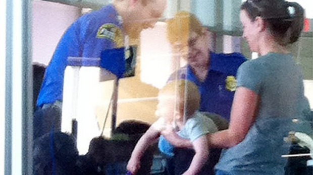 The photo taken of a baby being searched at Kansas Airport went viral after being posted on Twitter.