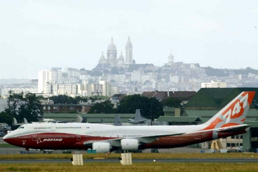 "The new Boeing 747-8 Intercontinental jetliner taxis, with ""le Sacre Coeur"" church in the background, on the eve of the ..."