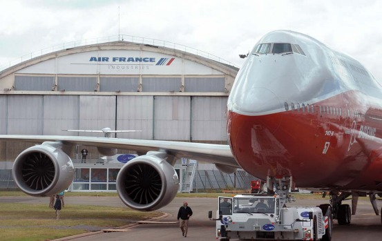 Boeing's new 747-8 Intercontinental long version of its famed jumbo jet landed outside Paris on Sunday a day ahead of ...