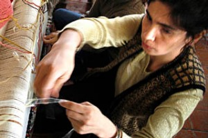 Women weave carpets at Qadim Quba (Ancient Quba), a formerly state-run firm based in the Azeri town of Quba,