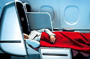 Qantas business class seat can be adjusted with various lumbar options and reclines to a flat bed.