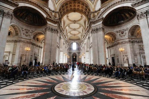 Visitors sit in St. Paul's Cathedral after its recent major restoration.