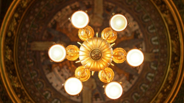 Lights hang from the ornate ceiling of a side passage in the newly restored St Paul's Cathedral.