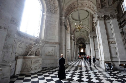 A Virger pauses to look at one of the statues in St. Paul's Cathedral after its recent major restoration.