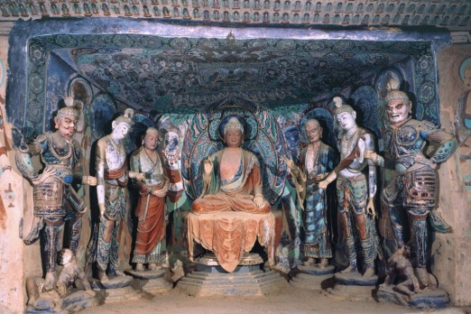 Buddha and disciples in the Mogao Caves, one of 500 painted caves remaining. Photo: Dunhuang Academy.