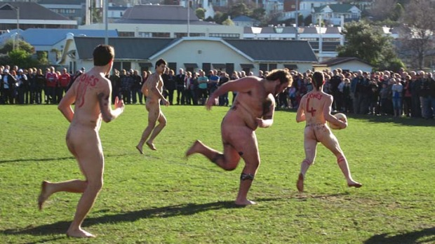 Bare aggression ... players take on the cold as well as each other at the annual Nude Rugby Test.