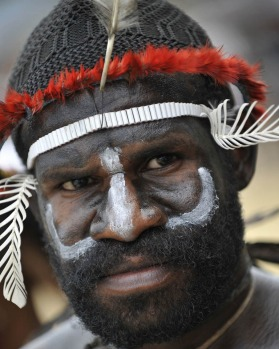 A Papuan tribesman participating in the Lake Sentani festival.