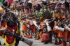 """Papuan tribesmen perform with their traditional drums known as """"tibas"""" during the Lake Sentani festival."""