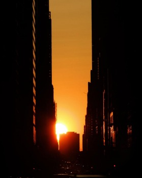 The sun sets on May 30, 2007 over the west side of New York City, known as Manhattanhenge, a term coined by an ...