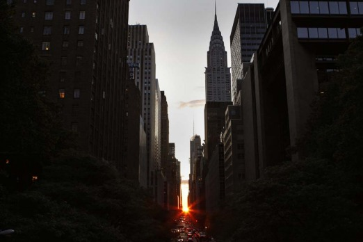 Manhattanhenge 2009. Manhattanhenge was named by astrophysicist Neil deGrasse Tyson and occurs when the setting sun ...