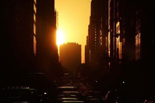 The sun sets on May 30, 2007 over the west side of New York City.