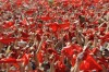 Revellers hold up their red scarves during the start of the San Fermin Festival in Pamplona.
