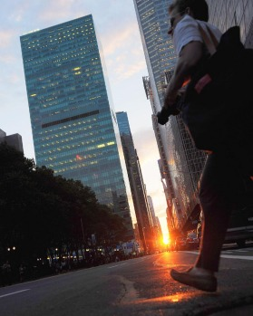 A pedestrian crosses 42nd street during Manhattanhenge.