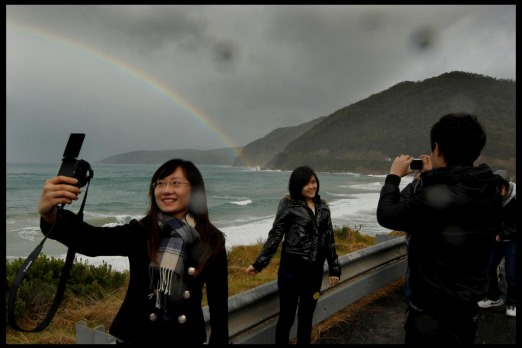 19 year old student Paulina Fu, takes her portrait with a rainbow background at one of the many lookout stops along The ...