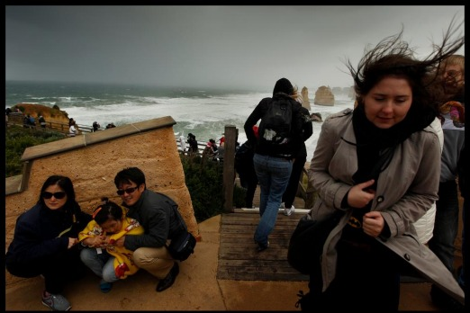 Fierce winds blowing across the viewing deck at the 12 Apostles tested the hardiness of travellers.