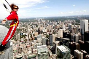 Toronto's downtown while participating in a media preview of EdgeWalk on the CN Tower.