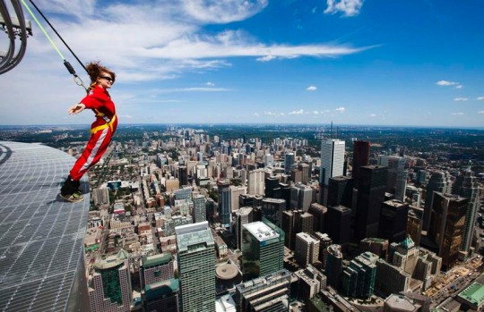 Daredevils in red jumpsuits can teeter around the outside edge of Canada's tallest structure next month as the CN Tower ...