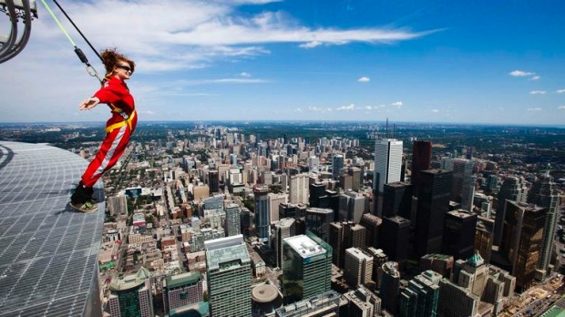 Daredevils in red jumpsuits can teeter around the outside edge of Canada's tallest structure next month as the CN Tower opens a new attraction for thrill-seekers and those wanting to overcome fear.