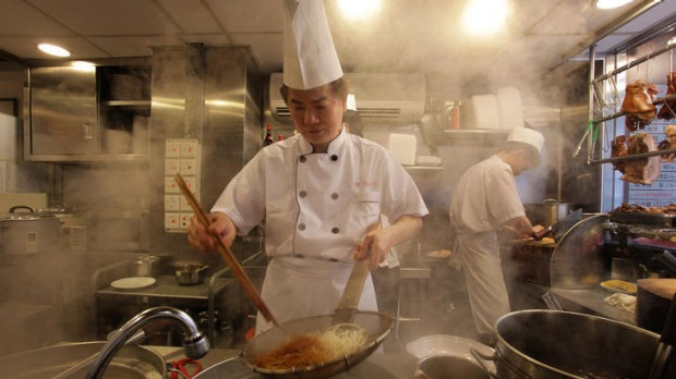 Haute Hong Kong ... Lai Wai Hung prepares noodles in his one-star restaurant, Hung's Delicacies.