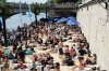 For the tenth summer, Paris transforms the banks of the Seine into full-fledged beaches with palm trees, outdoor showers ...