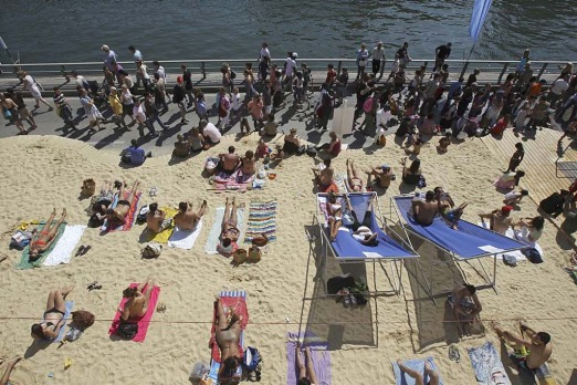 Tourists and Parisians take advantage of the Paris Plage event, an artificial beach set up annually on the right bank of ...
