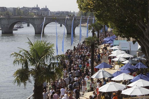 Tourists and Parisians take advantage of the Paris Plage event, an artificial beach set up on the right bank of the ...