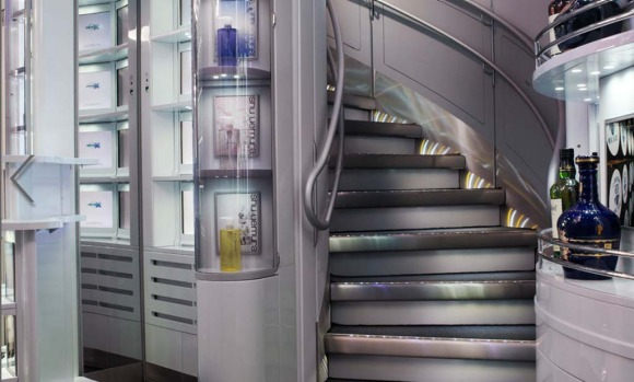 The staircase to the aircraft's upper deck and the duty free store.