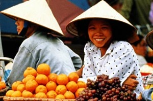 Fresh food people ... footpath snacking and market shopping several times a day are part of life in the Vietnamese ...