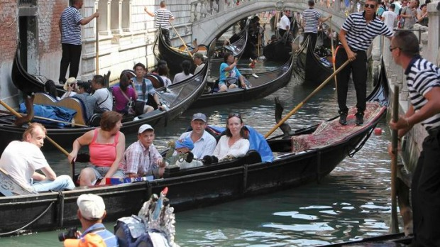 The flat-bottomed gondolas are a Venetian fixture, but they are vulnerable to the sudden wash from passing motorboats.