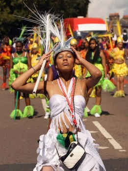 Police were out in force, but London's colourful Notting Hill Carnival gets off to a peaceful start , defying fears that ...