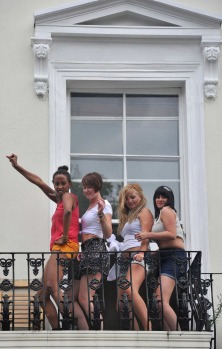 Onlookers get into the spirit of things at the Notting Hill Carnival.