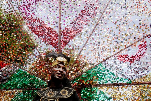 A performer dances in the street parade at the annual Notting Hill Carnival in central London. Revellers flocked to west ...