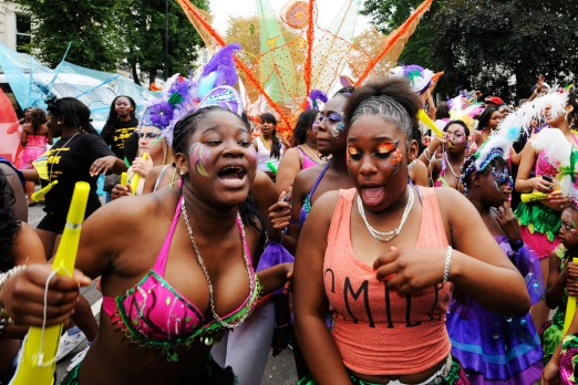 Performers dance during  Notting Hill Carnival last day in London. Photo by AFP