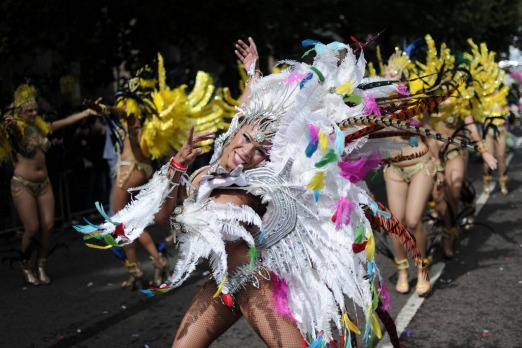 Performers take part in the Notting Hill Carnival in London. Photo by AFP