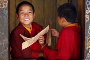 Photo taken on October 7, 2010 shows young monks learning religious texts in the Temple of the Divine Madman in the ...