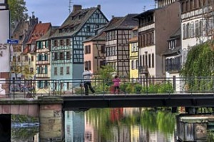 Colorful traditional houses in the 'Petite france' area and their reflections on the river, Strasbourg, Alsace, France.