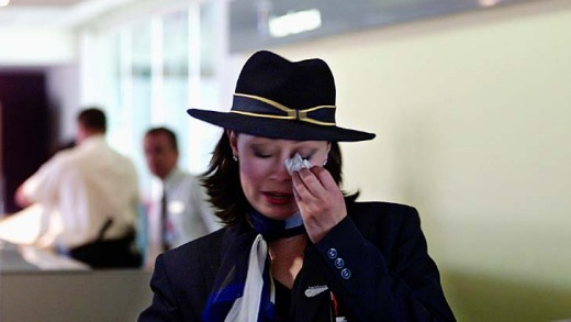 The end ... a tearful Ansett employee during the final days of the airline.
