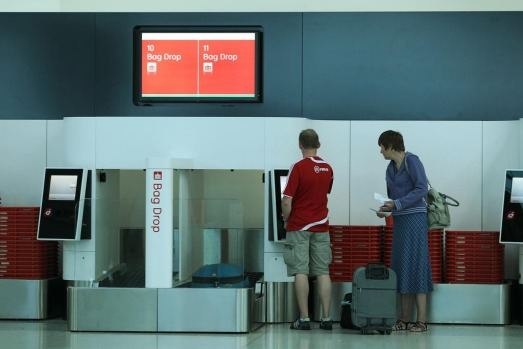 It's business as usual for passengers at the Qantas bag drop area during a nationwide Qantas crew strike.
