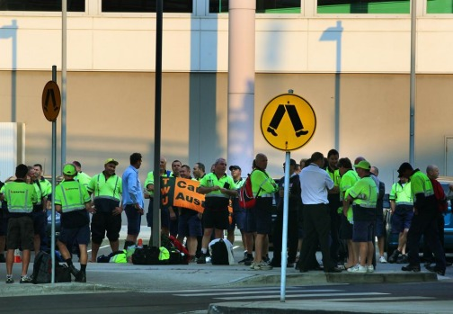 Qantas employees gather outside Sydney Airport during a nationwide crew strike including baggage handlers, ground staff, ...