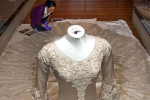 Specialist Textile Installer, Keira Millar from the Victorian and Albert Museum inspects a dress at the Bendigo Art ...