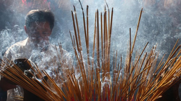 Locals burning incense during Vietnamese lunar New Year celebrations.