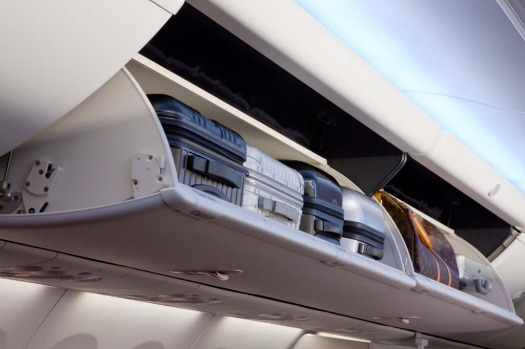 The new 737 interiors feature larger overhead lockers for cabin baggage.